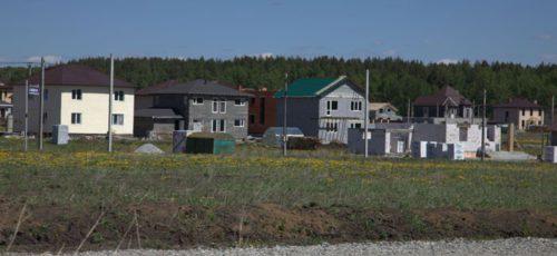 Что собой представляет коттеджный поселок под Уфой, и в чем его особенности?